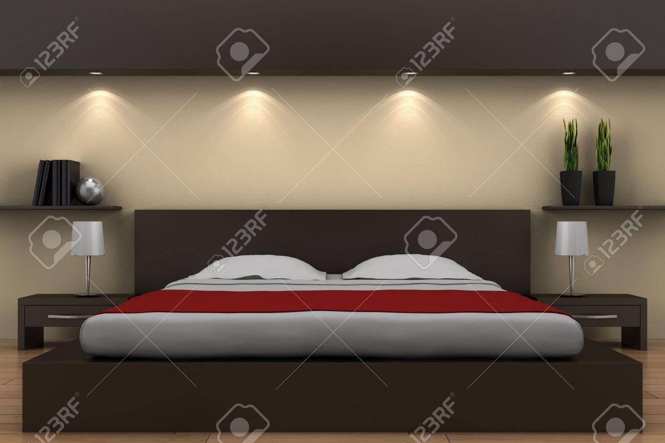 Moderne Schlafzimmer Mit Braunen Bett Und Beige Wand Lizenzfreie ...