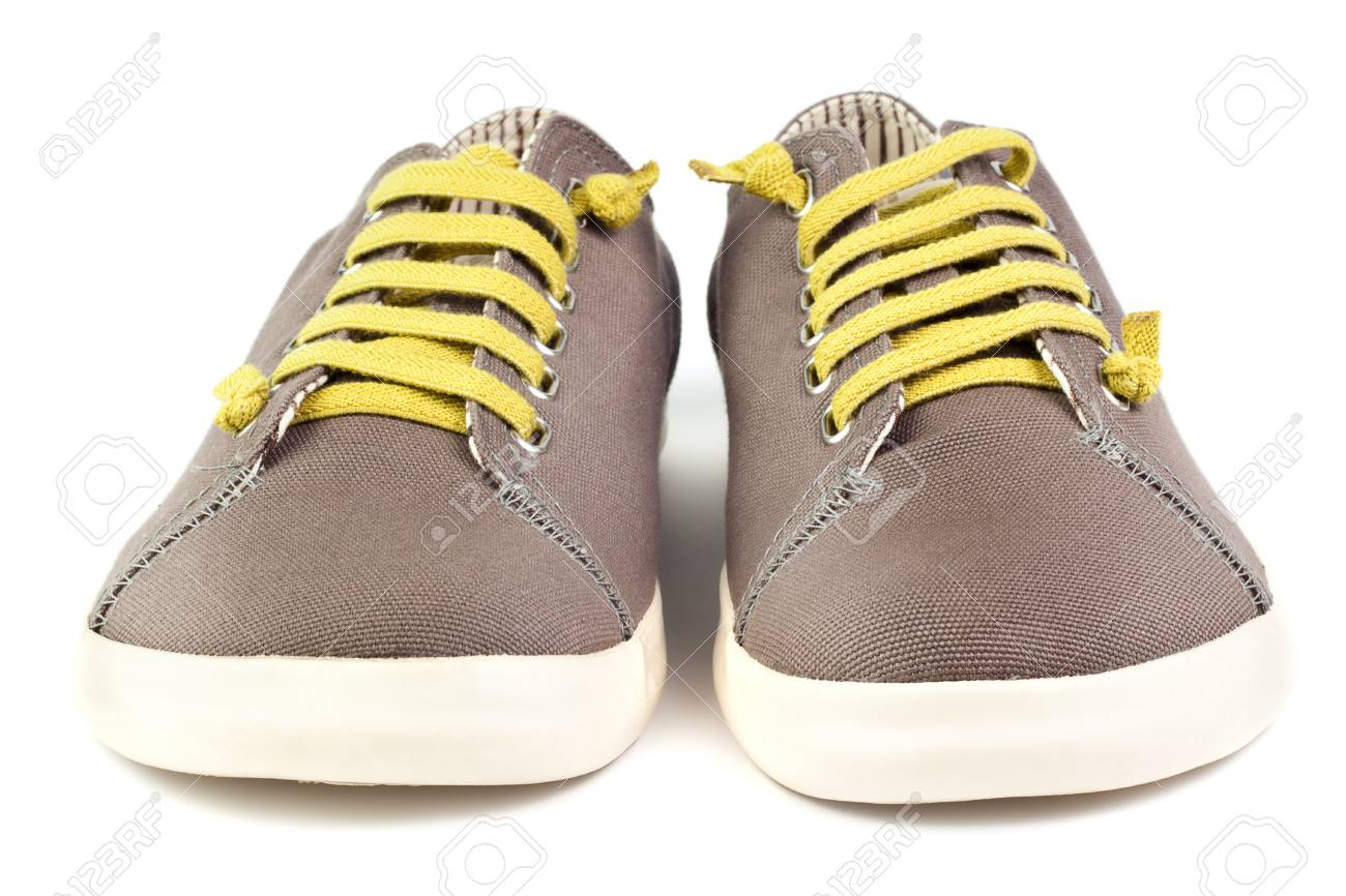 pair of brown men sneakers isolated on white background Stock Photo - 9876353