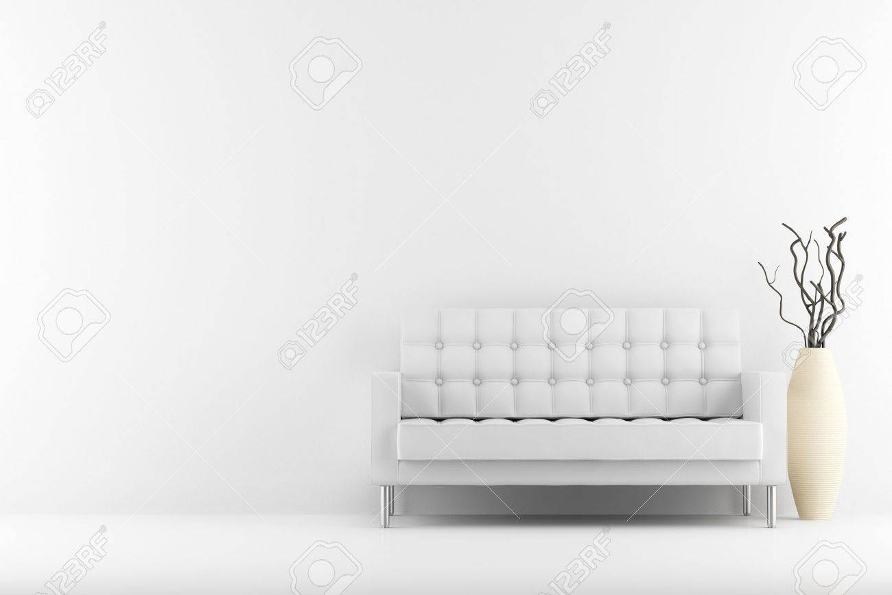 leather couch and vase with dry wood in front of white wall - 10422078