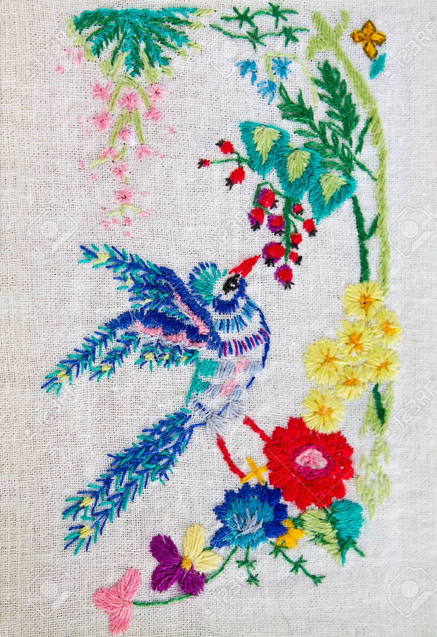 Embroidered Satin Stitch Bird With Flowers Closeup Stock Photo