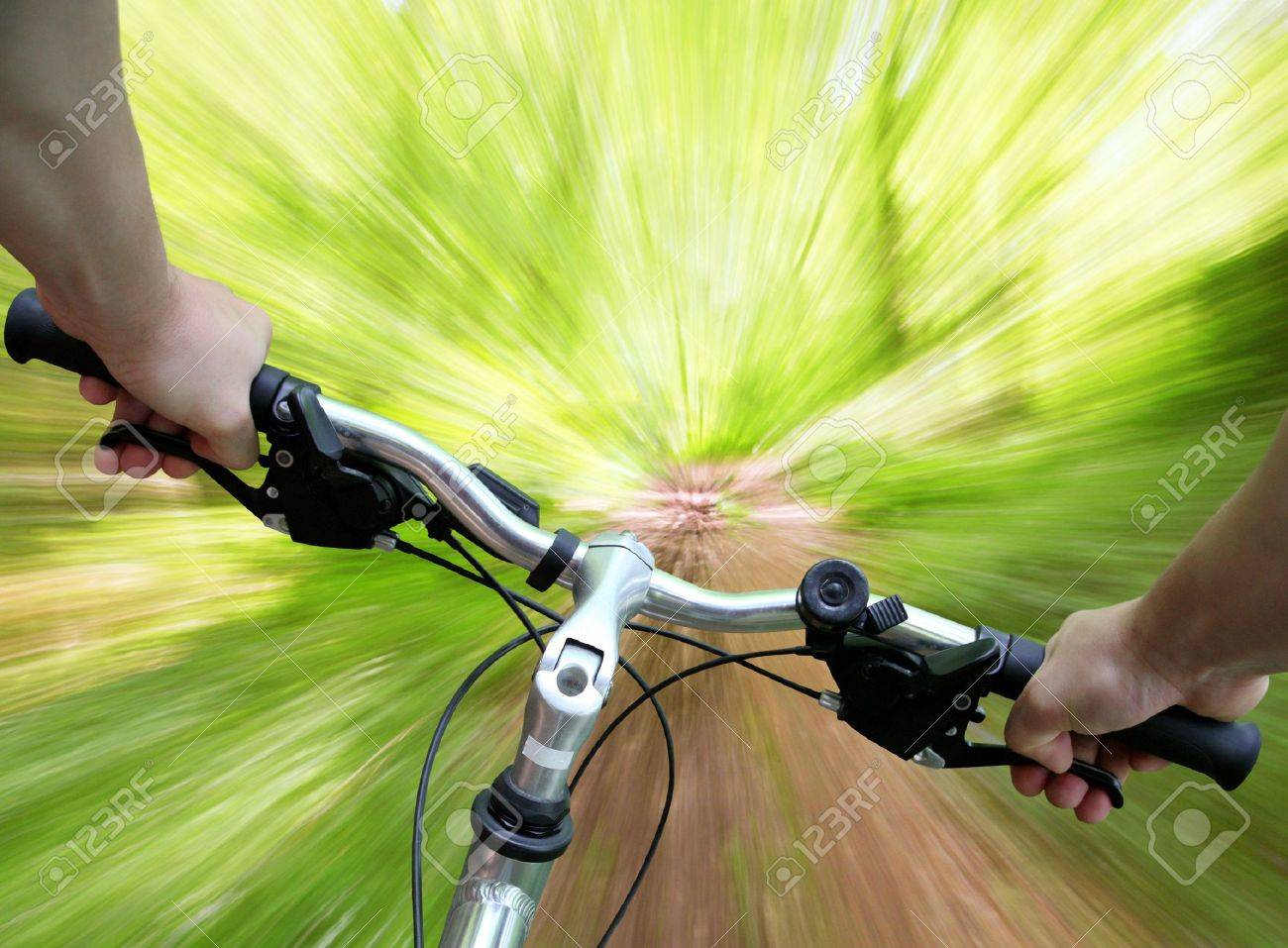 Mountain biking down the trail, descending fast, subjective point of view Stock Photo - 3109589