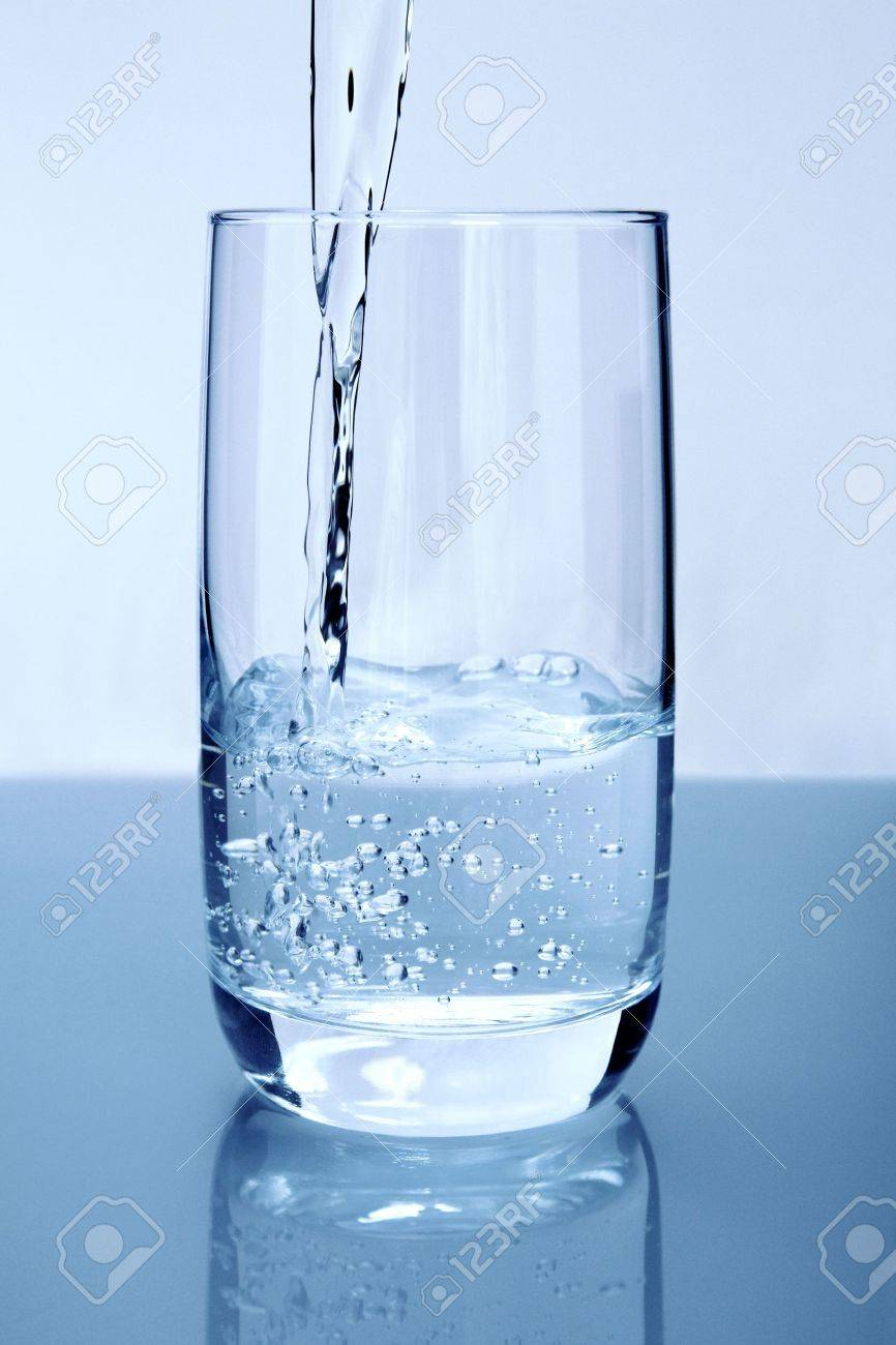 Pouring pure water in a glass Stock Photo - 3858794