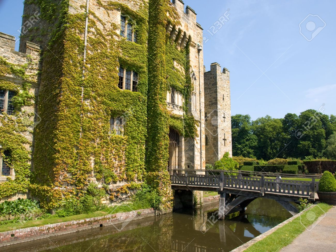 An Old English Castle With A Bridge Over A Moat Stock Photo Picture