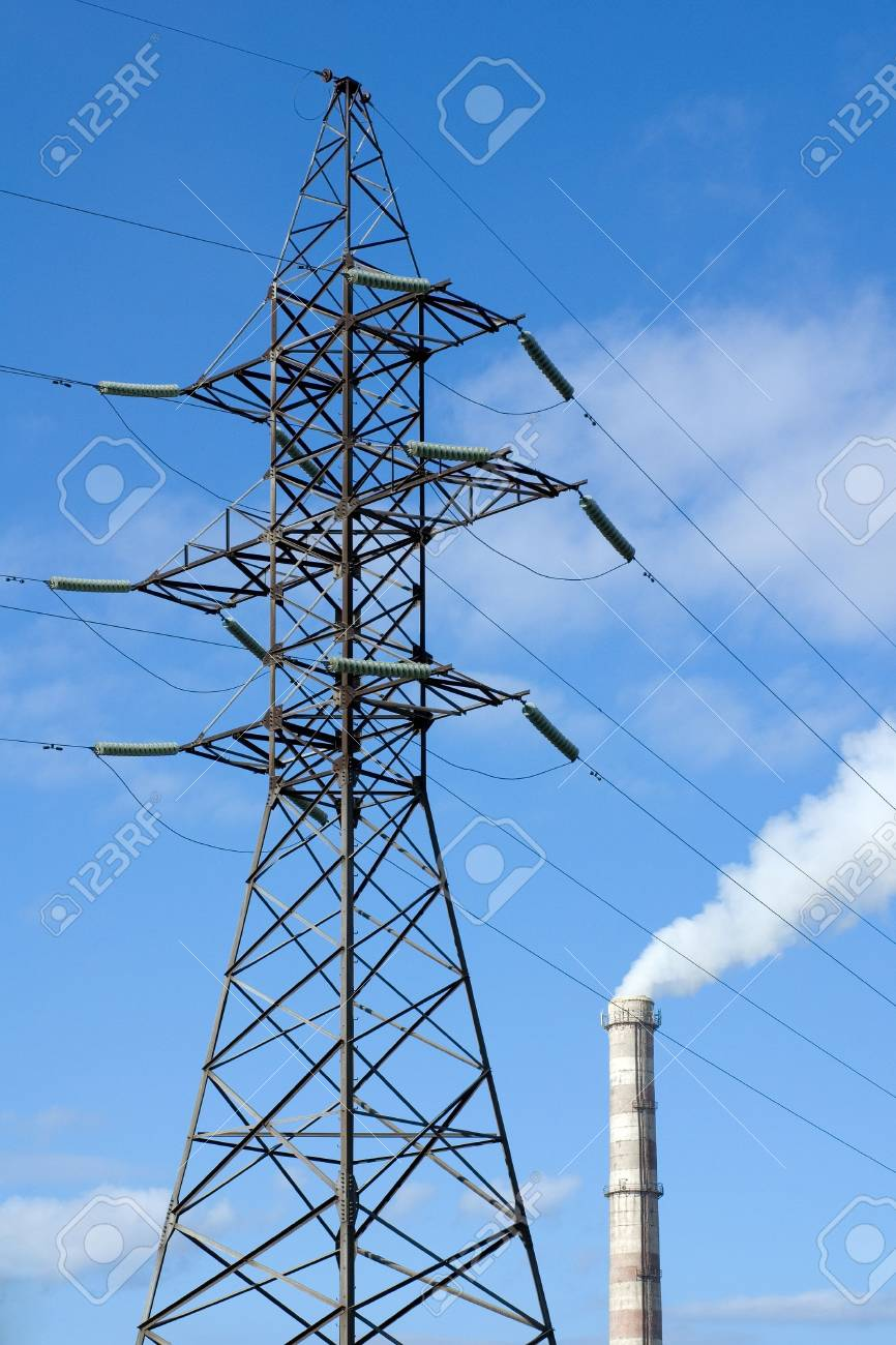 Electricity pylon and smoking factory pipe Stock Photo - 6402482
