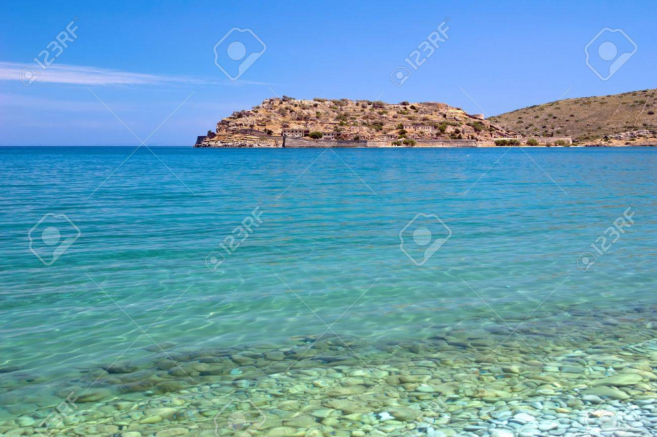 The View Of The Spinalonga Island From The Pebble Beach Crete