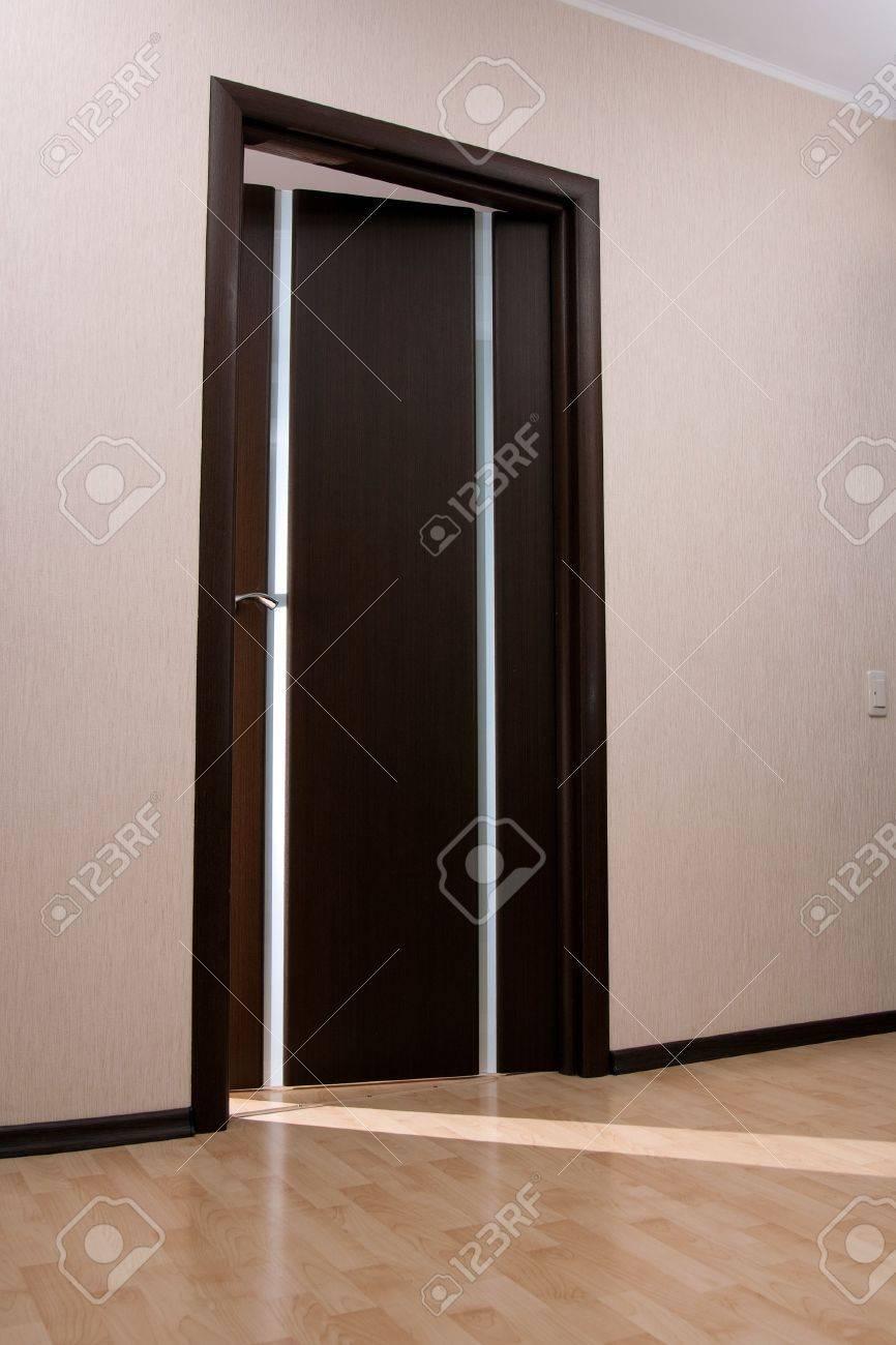 Beam of light from ajar wooden door Stock Photo - 6429506