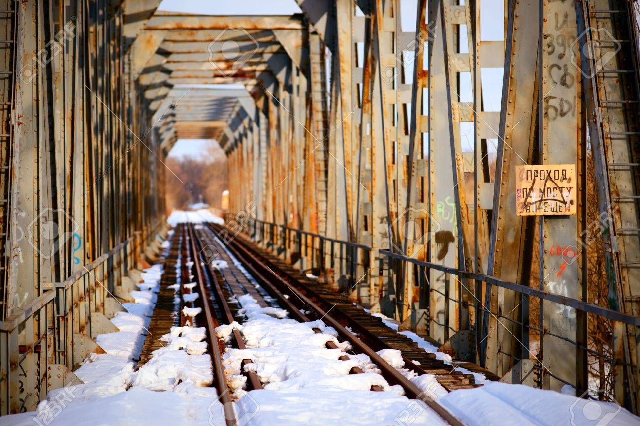 Rusty bridge and abandoned railroad tracks in winter Stock Photo - 6679504