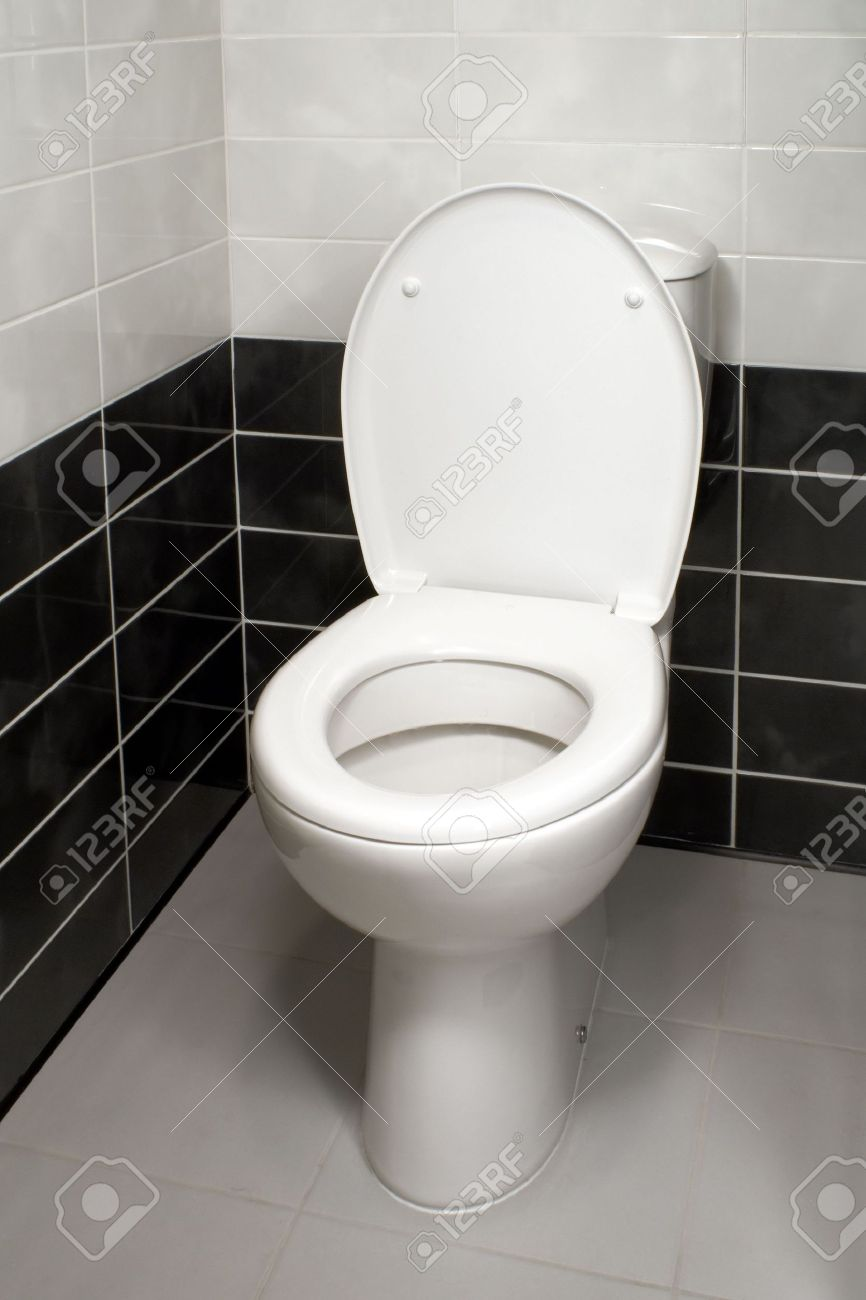 Stock Photo White toilet bowl with open toilet seat cover. Bathroom Toilet Seat Covers