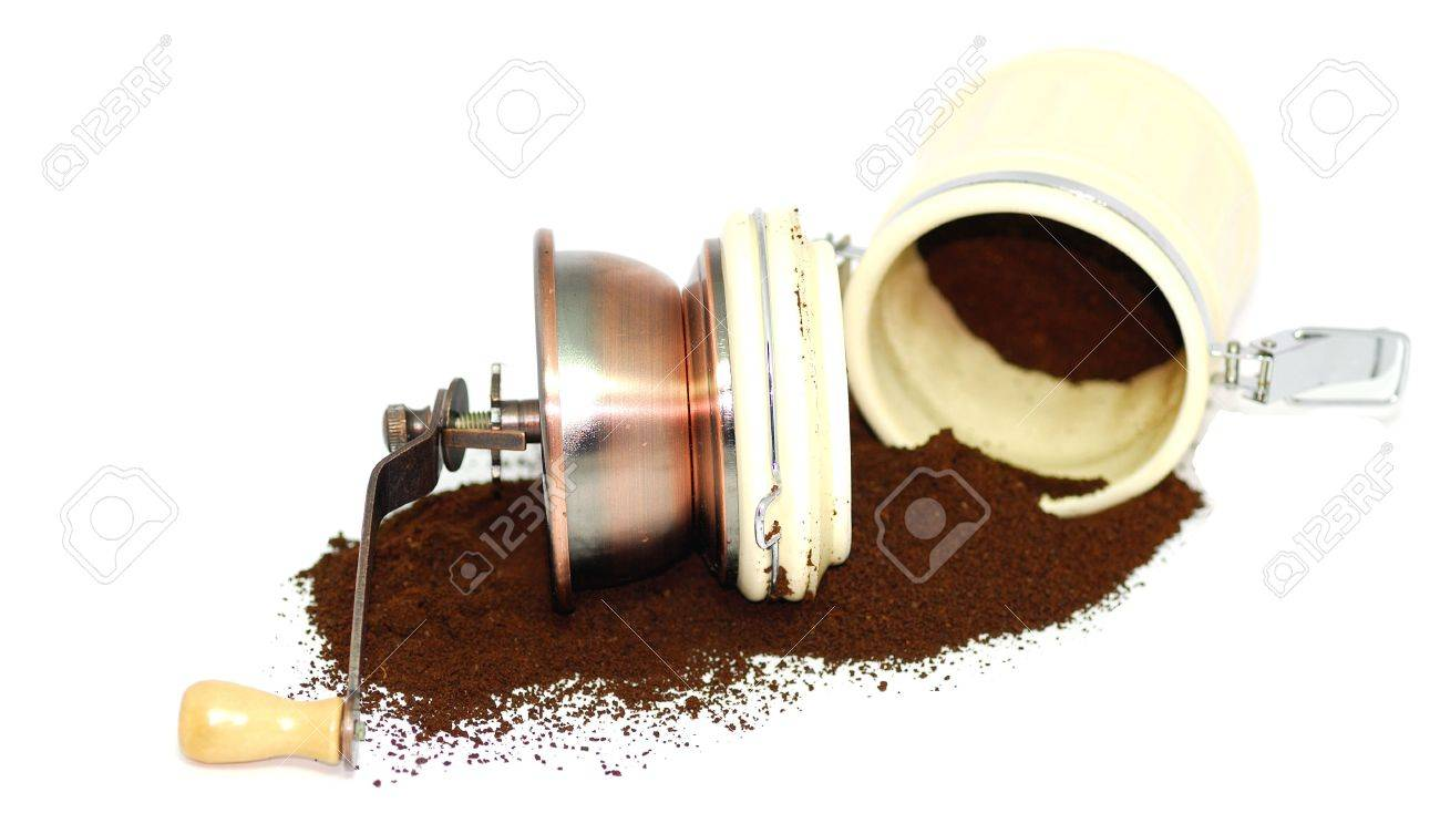 hand coffee grinder with grounded powder Stock Photo - 4458877