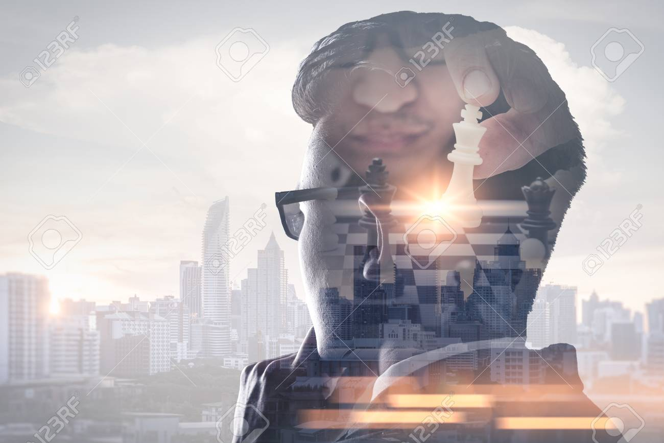 The double exposure image of the businessman thinking overlay with chess game and cityscape image. the concept of strategic, planning, management, intelligence and education. - 108368771