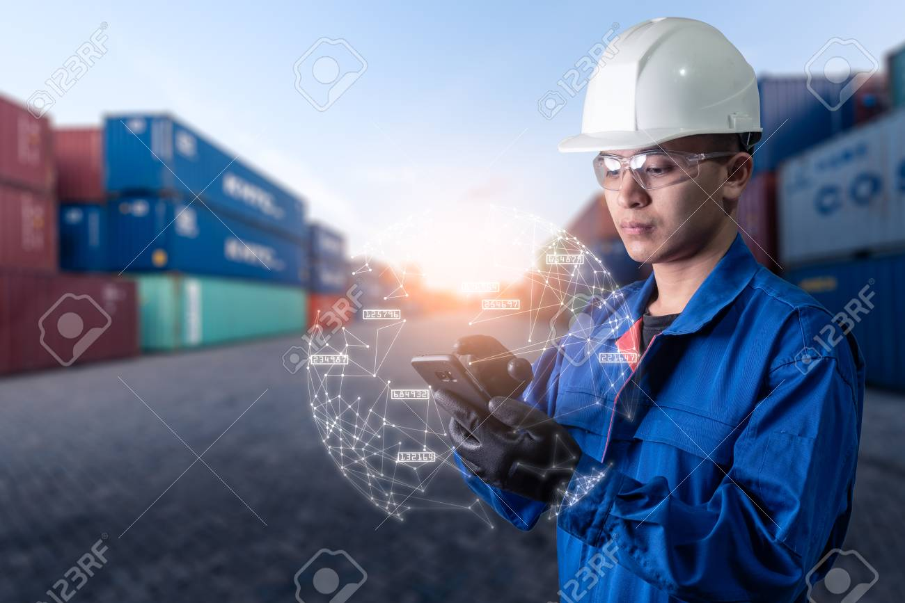 The abstract image of engineer point to the hologram on his smartphone and blurred container yard is backdrop. the concept of communication network internet of things and logistic. - 108568926