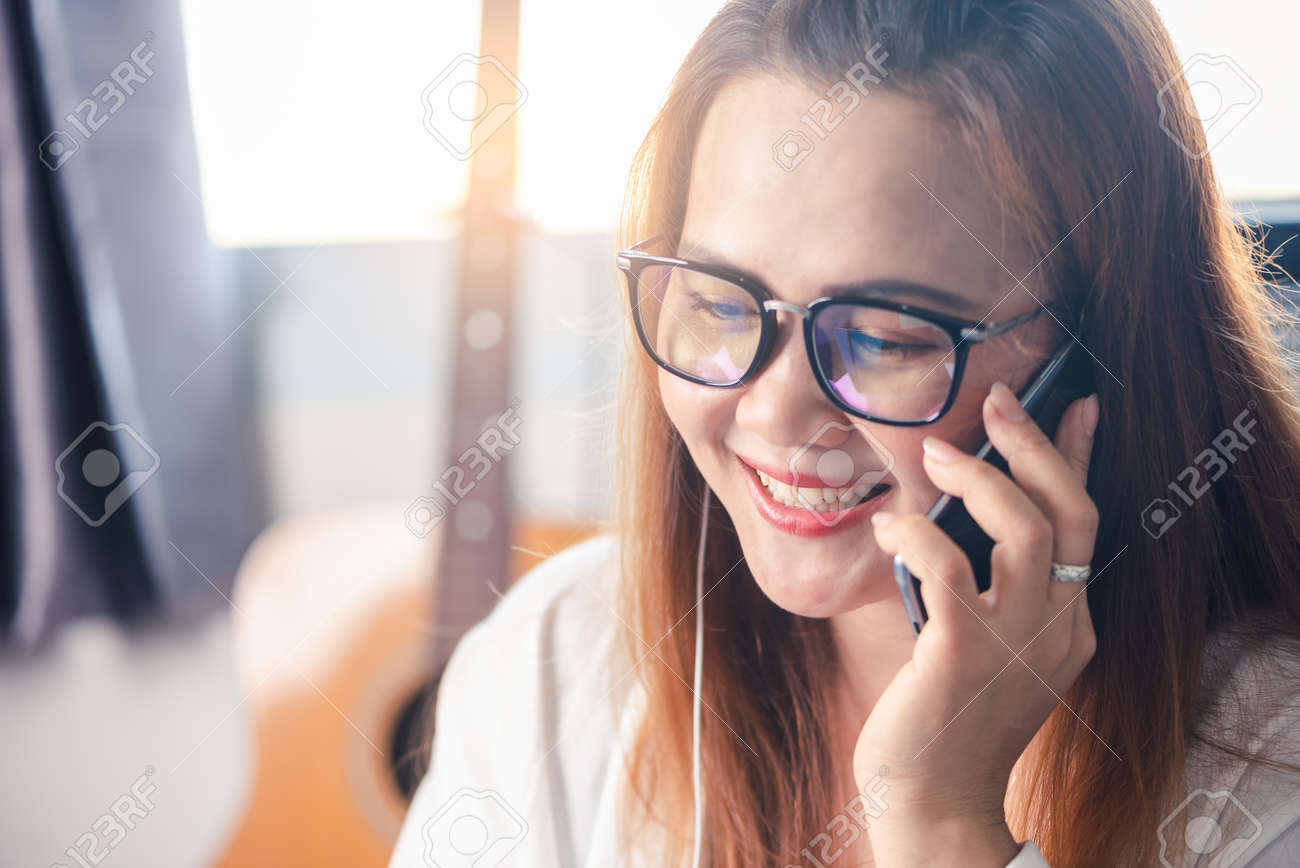 the abstract image of the businesswoman is quarantining herself and calling to another one via a smartphone at her home. the concept of covit-19, work at home, quarantine, healthcare and business. - 155501567