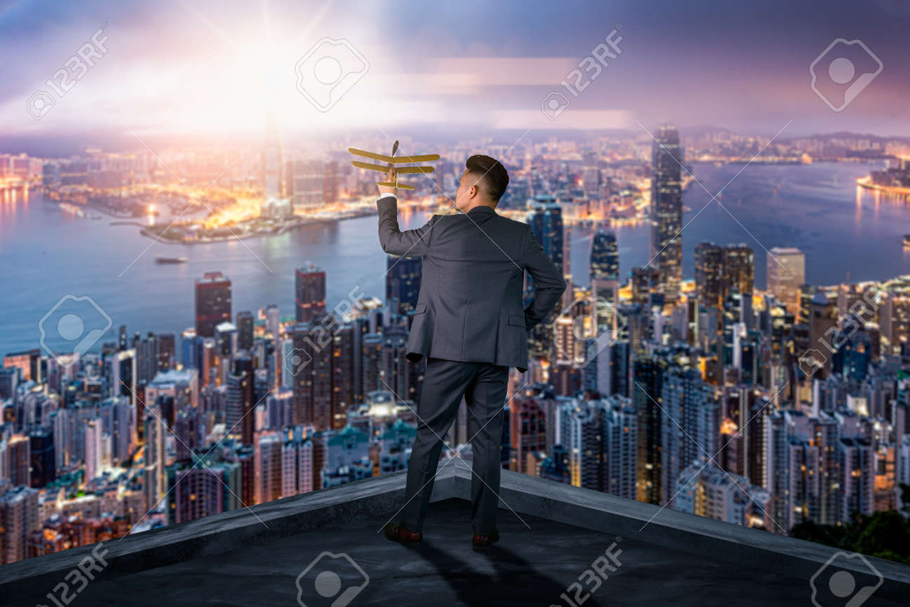 The double exposure image of the businessman standing back during sunrise overlay with cityscape image. The concept of modern life, business, city life and internet of things. - 155918021