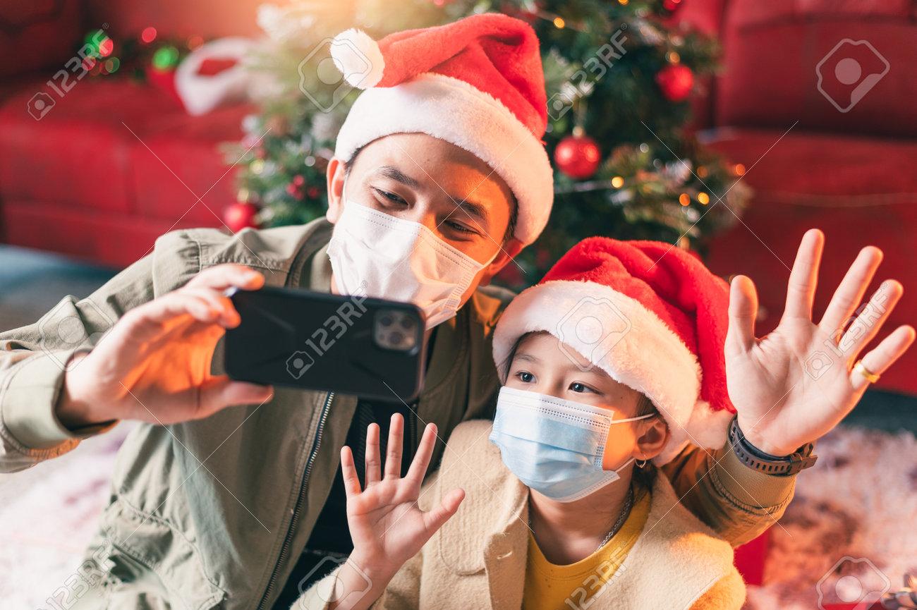 the family celebrating Christmas festival during Coronavirus pandemic. the concept of Christmas, festival, Coronavirus, COVID-19 and health care - 160156481