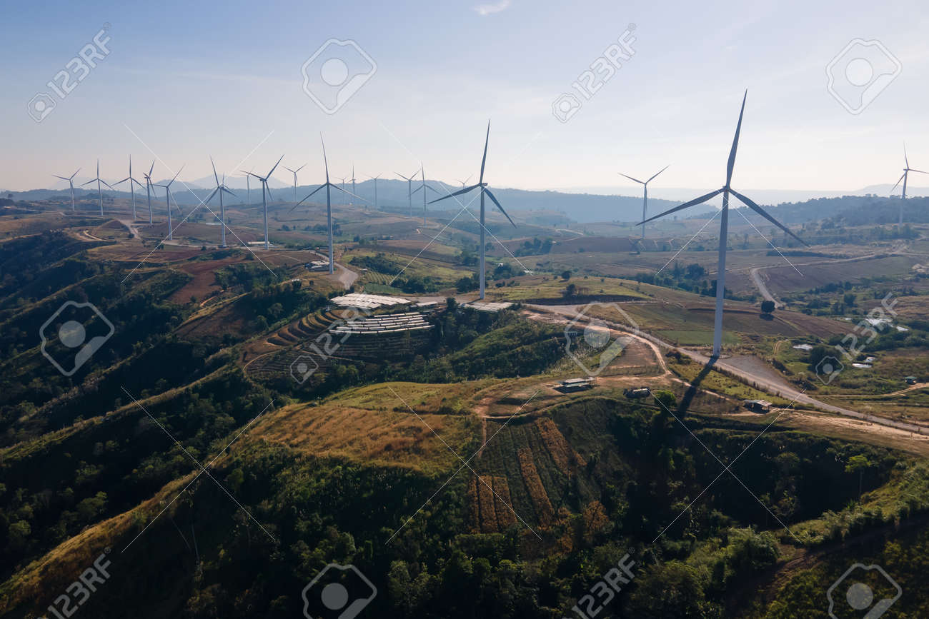 the wind turbines field and the sunrise. the concept of clean energy, environment, electricity and Industrial - 161908034