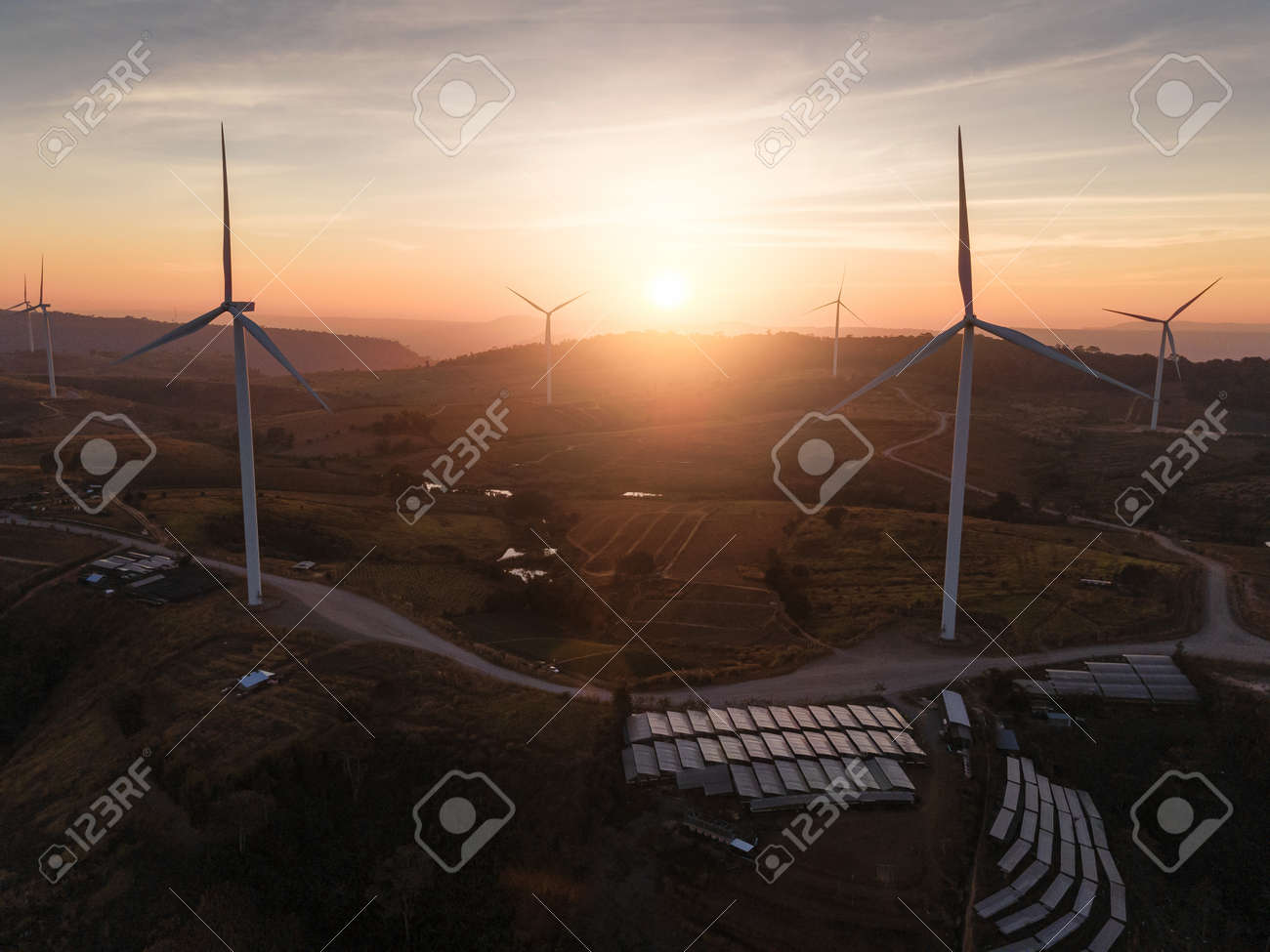 the wind turbines field and the sunrise. the concept of clean energy, environment, electricity and Industrial - 161907843