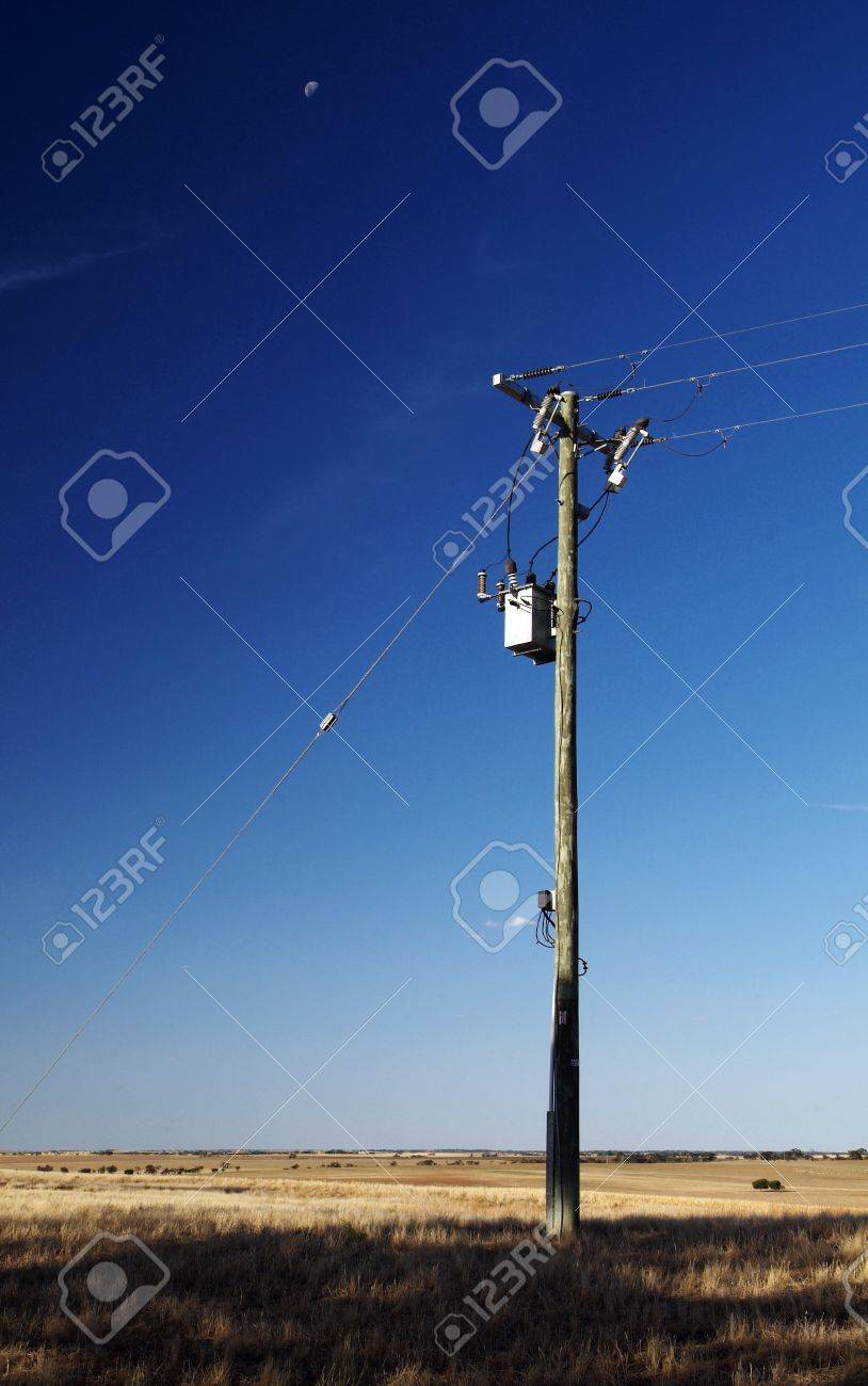 Single power pole on blue sky Stock Photo - 6949190