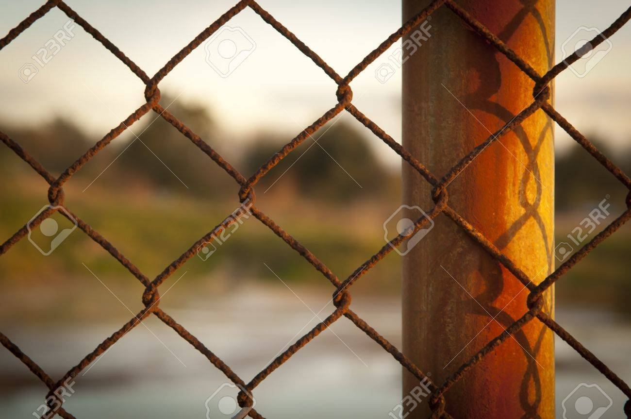 Rusty Wire Fence (cylcone Fencing) In Repeating Patterns Stock Photo ...