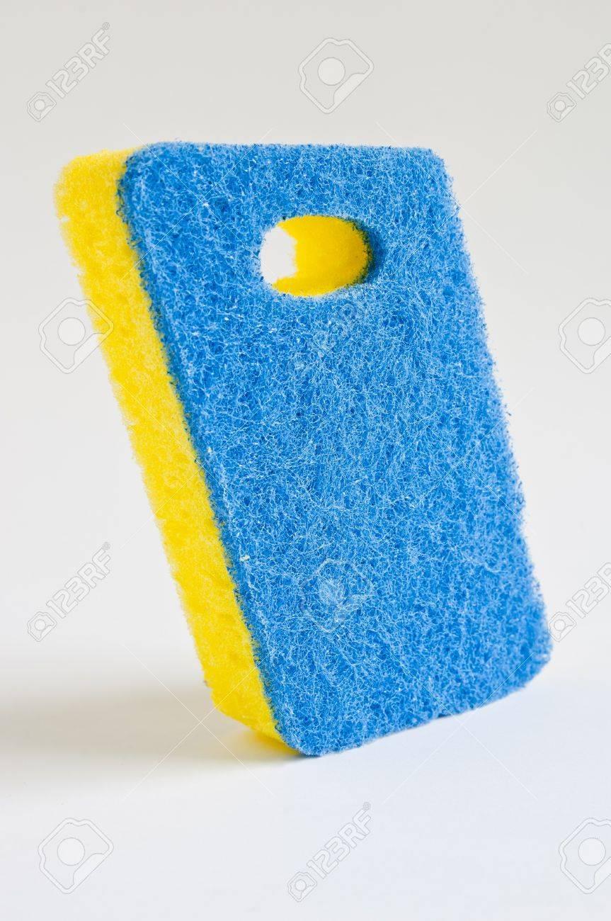 Blue and yellow scrubbing sponge / scourer Stock Photo - 8024756