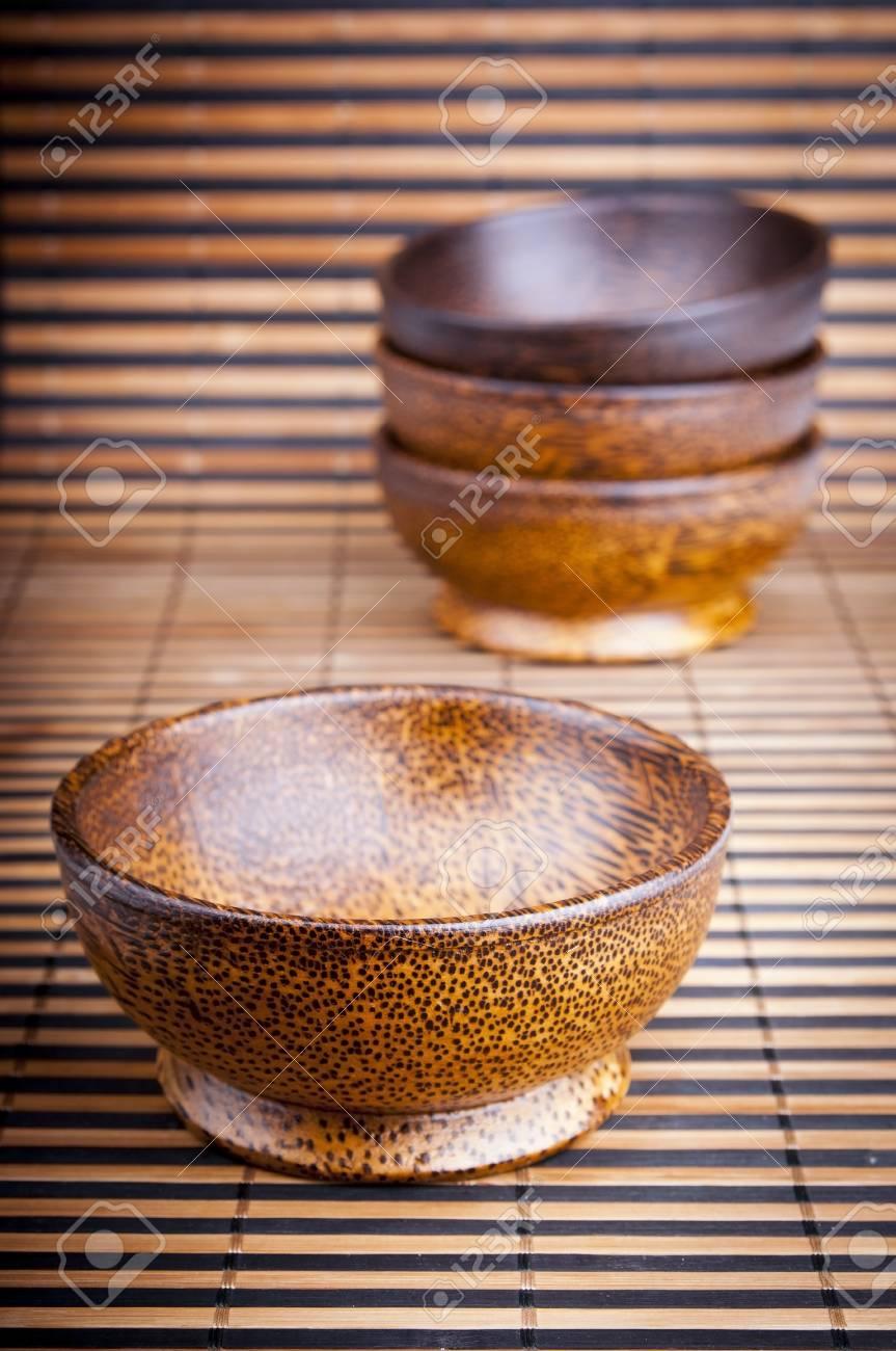 Handmade Wooden Bowls On A Bamboo Mat