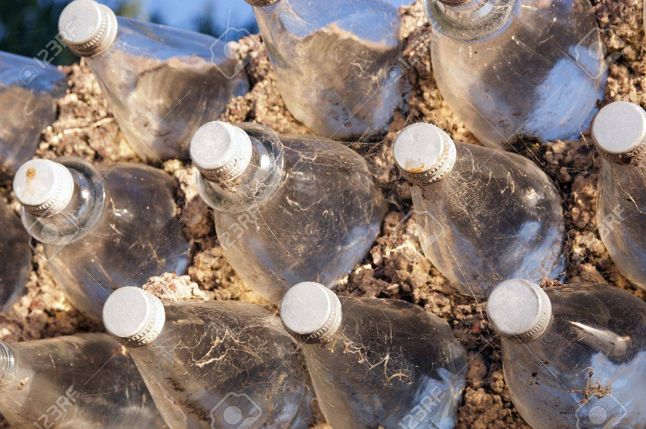 Old glass bottles used to build a wall as a background texture Stock Photo - 14187814