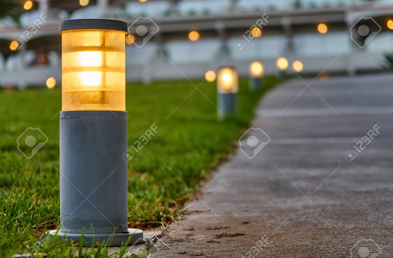 Stock Photo - Street lights located along the footpath on the grass & Street Lights Located Along The Footpath On The Grass Stock Photo ...