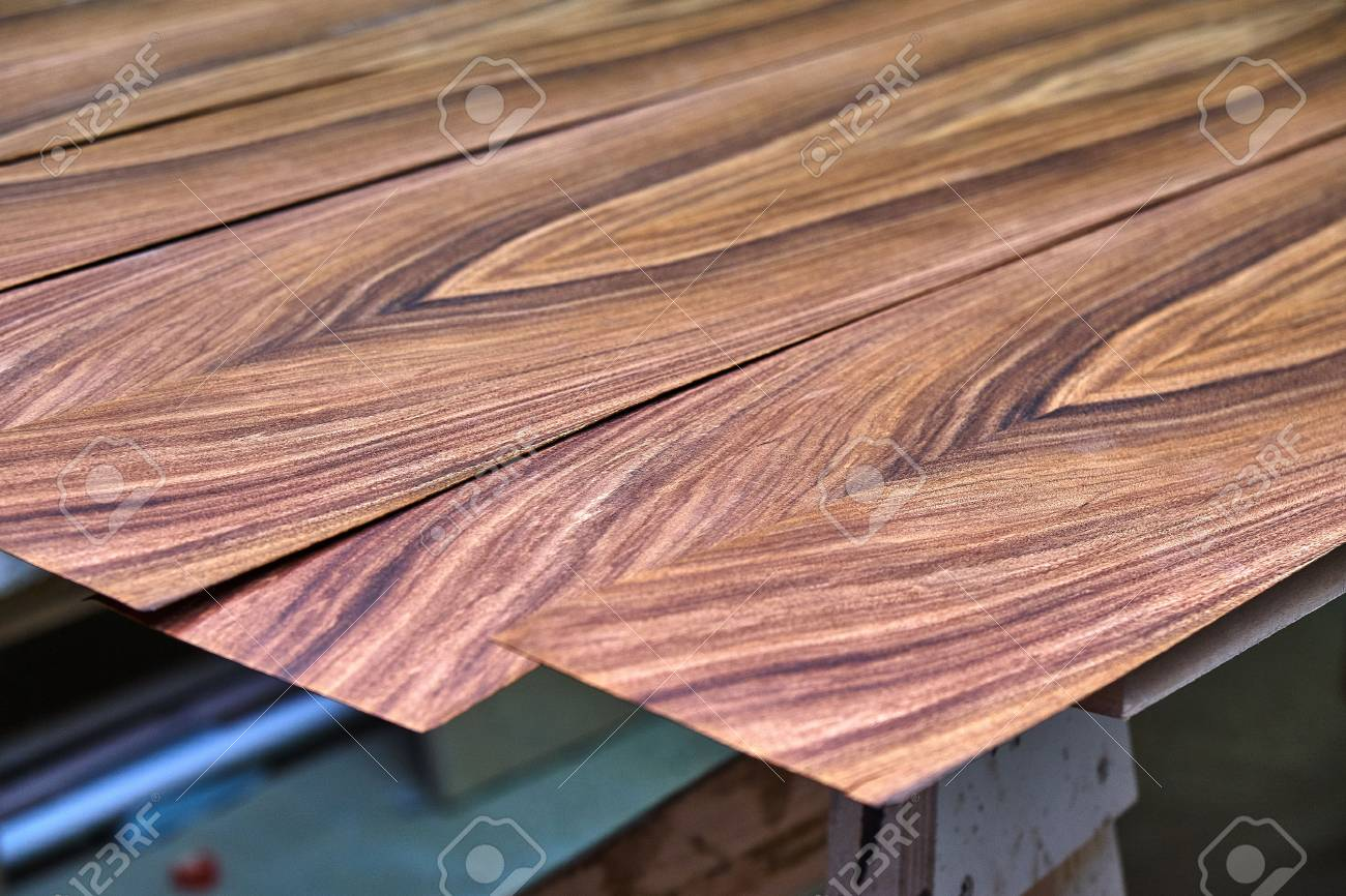Veneer Santos Rosewood. Wood texture. Woodworking and carpentry production. Close-up. Furniture manufacture - 116637232