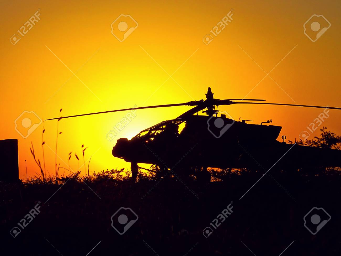 helicopter rests in the iraq sunset stock photo, picture and royalty