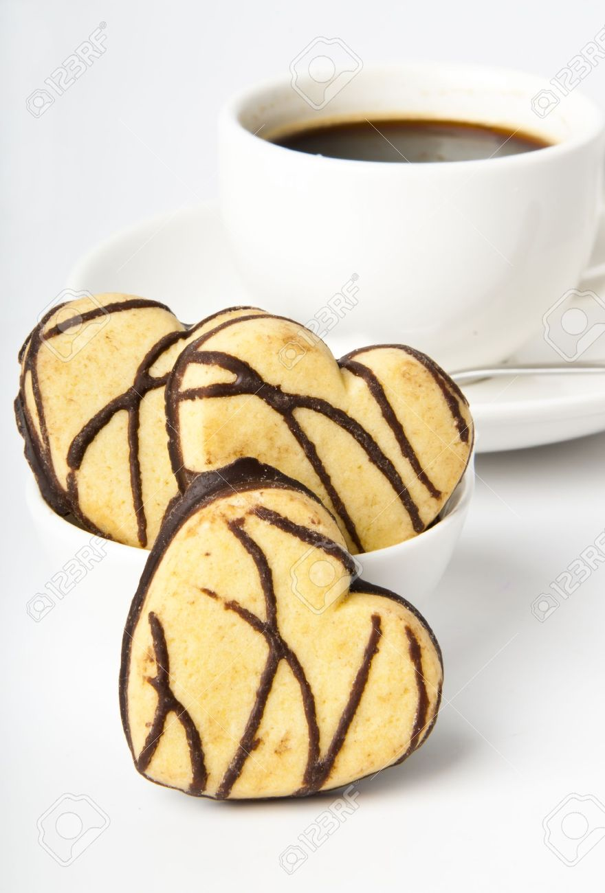 Cookie Coffee Cups Cup Of Coffee And Cookies In A Heart Shaped Chocolate Stock Photo