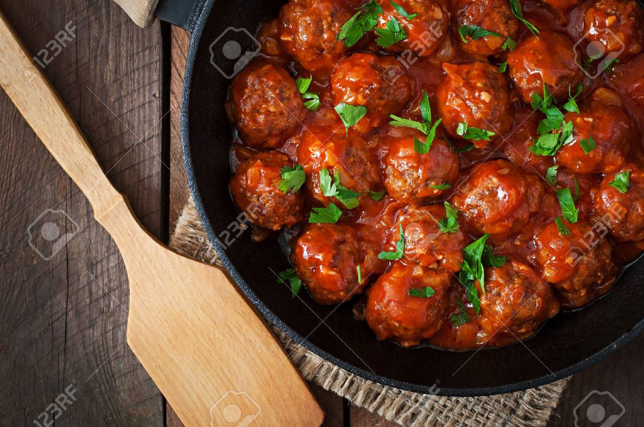 Meatballs in sweet and sour tomato sauce - 42724753