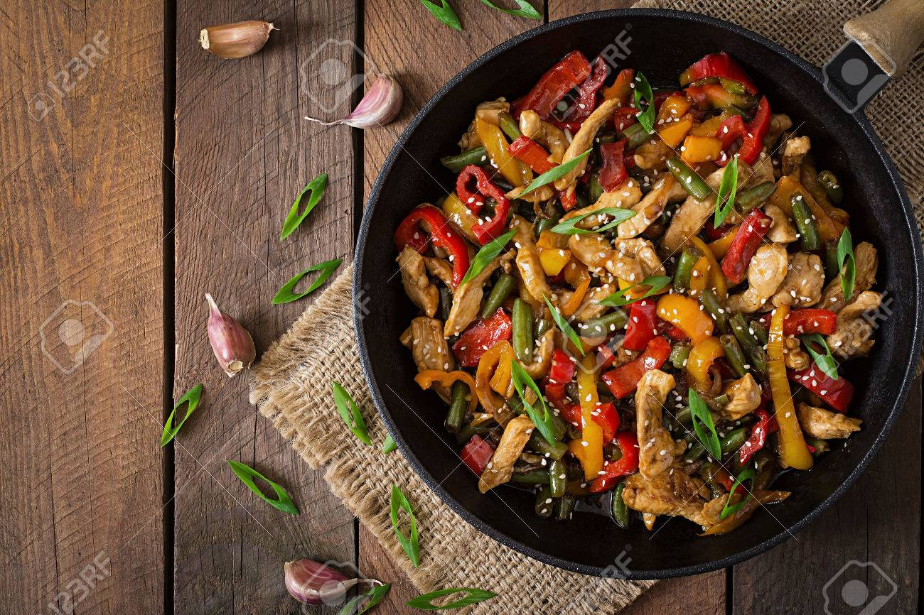 Stir fry chicken, sweet peppers and green beans. Top view - 46016044