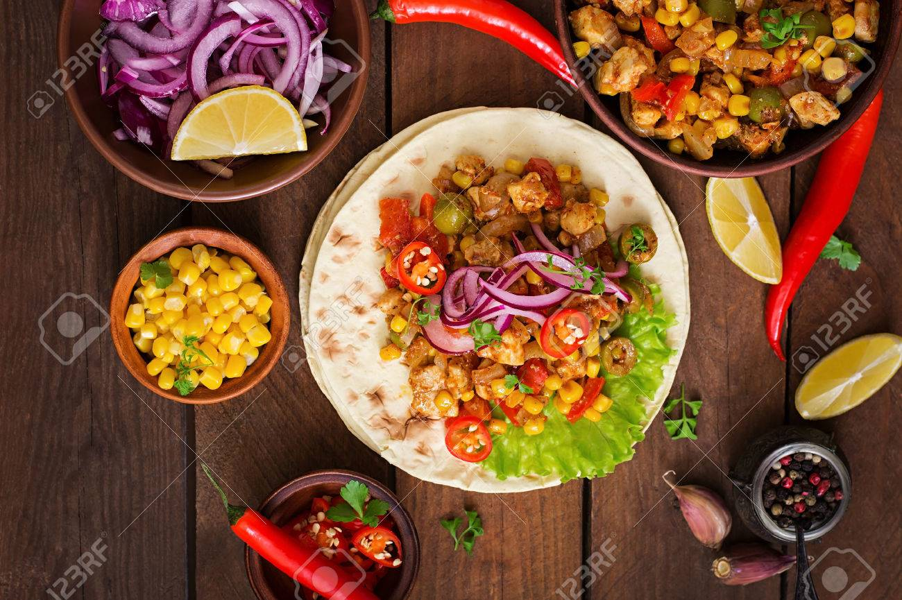 Mexican tacos with meat, corn and olives on wooden background. Top view - 51630921