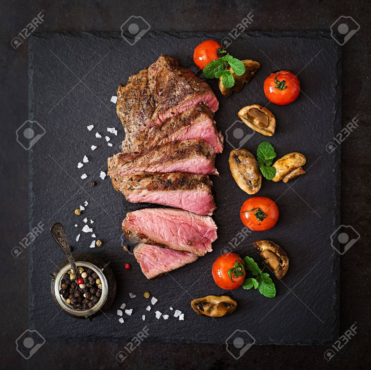 Juicy steak medium rare beef with spices and grilled vegetables. Top view - 54281344