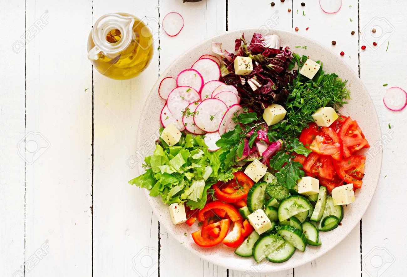 Mix salad from fresh vegetables and greens herbs. Dietary menu. Proper nutrition. Healthy lifestyle. Flat lay. Top view - 91019160