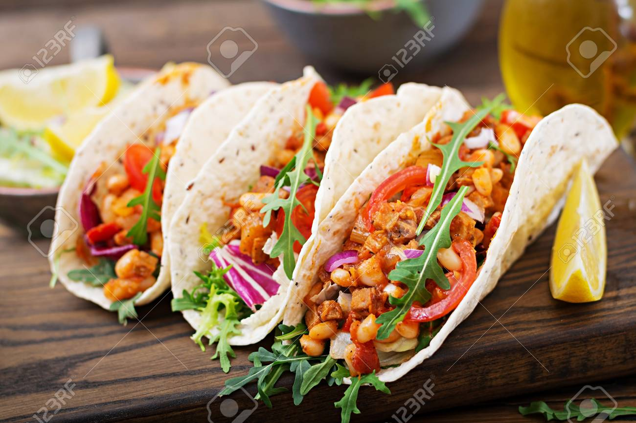 Mexican Tacos With Beef Beans In Tomato Sauce And Salsa Stock Photo Picture And Royalty Free Image Image 95820155
