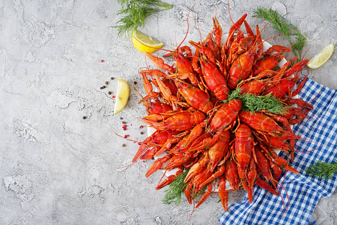 Crayfish. Red boiled crawfishes on table in rustic style, closeup. Lobster closeup. Border desig. Top view - 105793801