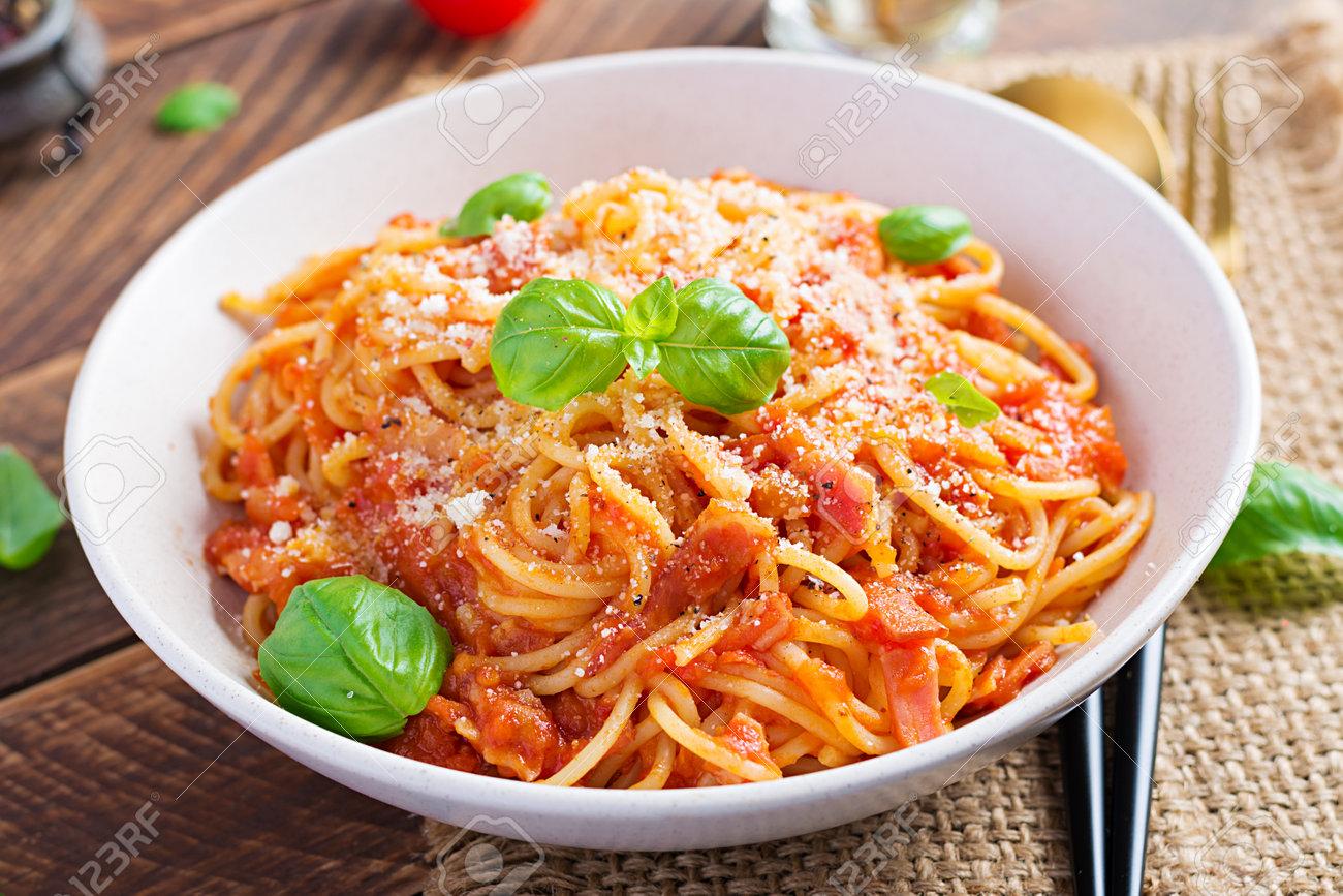 Spaghetti alla Amatriciana with guanciale, tomatoes and pecorino cheese. Italian healthy food. - 168174318