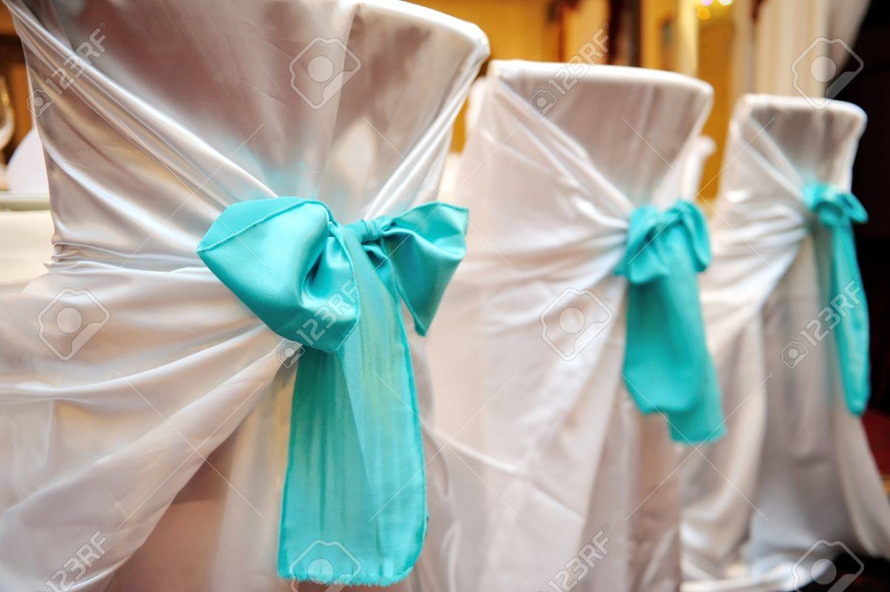 Turquoise And White Wedding Decorations Wedding Decorations In The Restaurant Chairs With White Cover