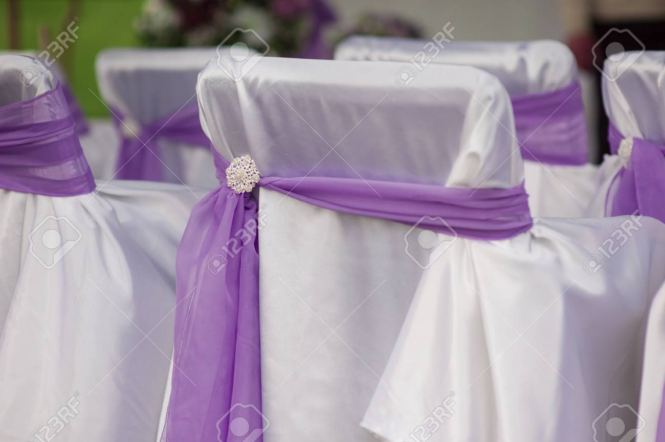 Beautiful White Wedding Chairs Decorated With Purple Bows. Stock Photo    39900143