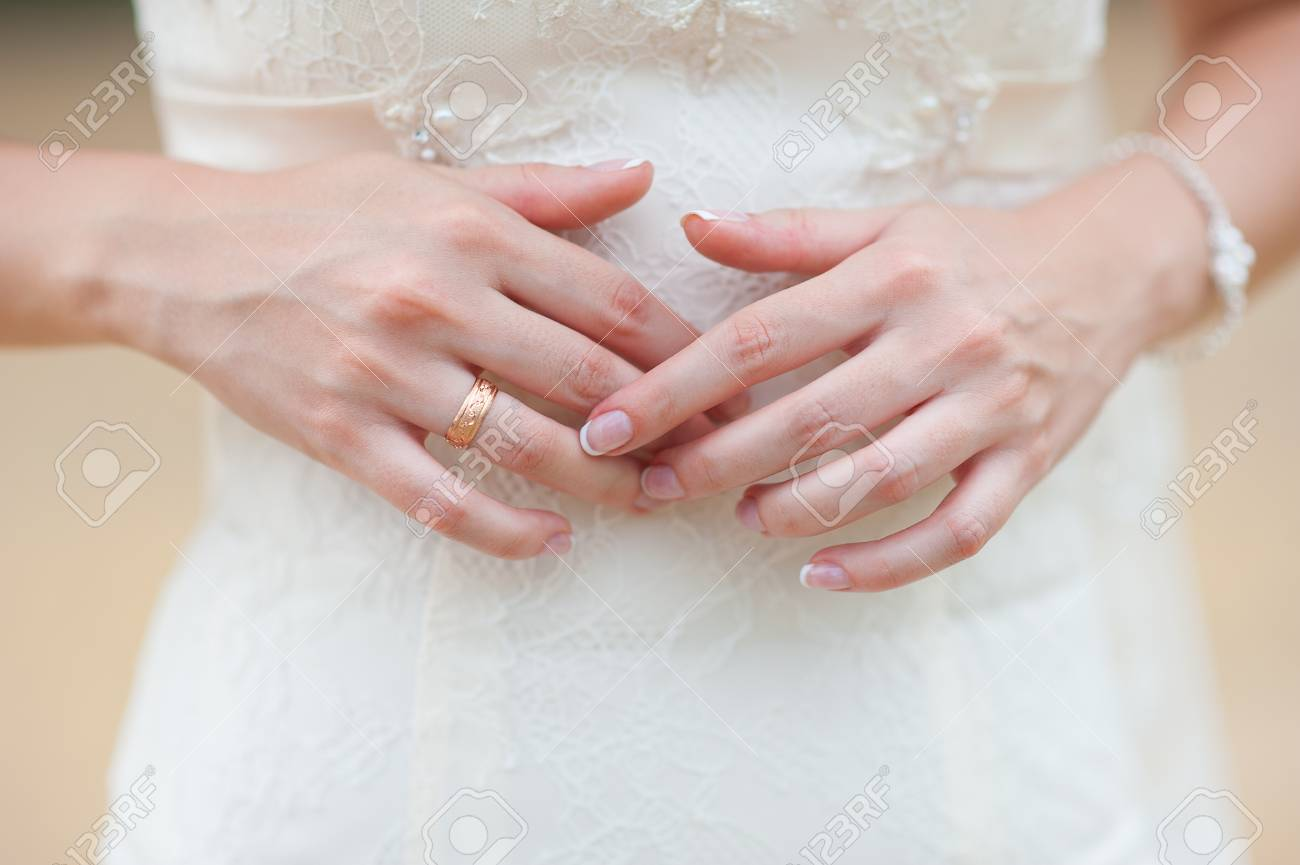 Hands Of A Bride With A Ring And A Beautiful Wedding Manicure. Stock ...