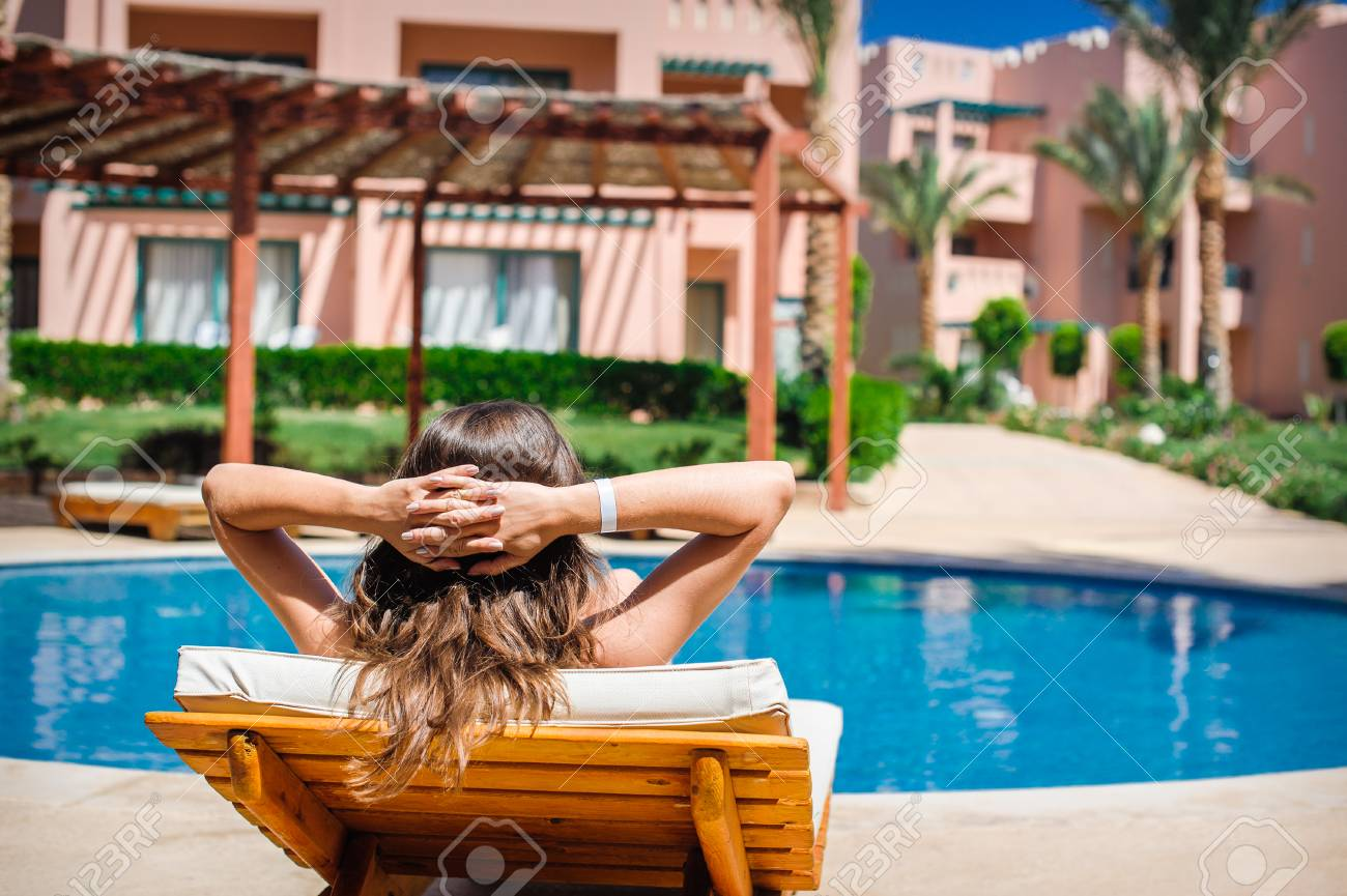 woman lying on a lounger by the pool at the hotel. - 43152403