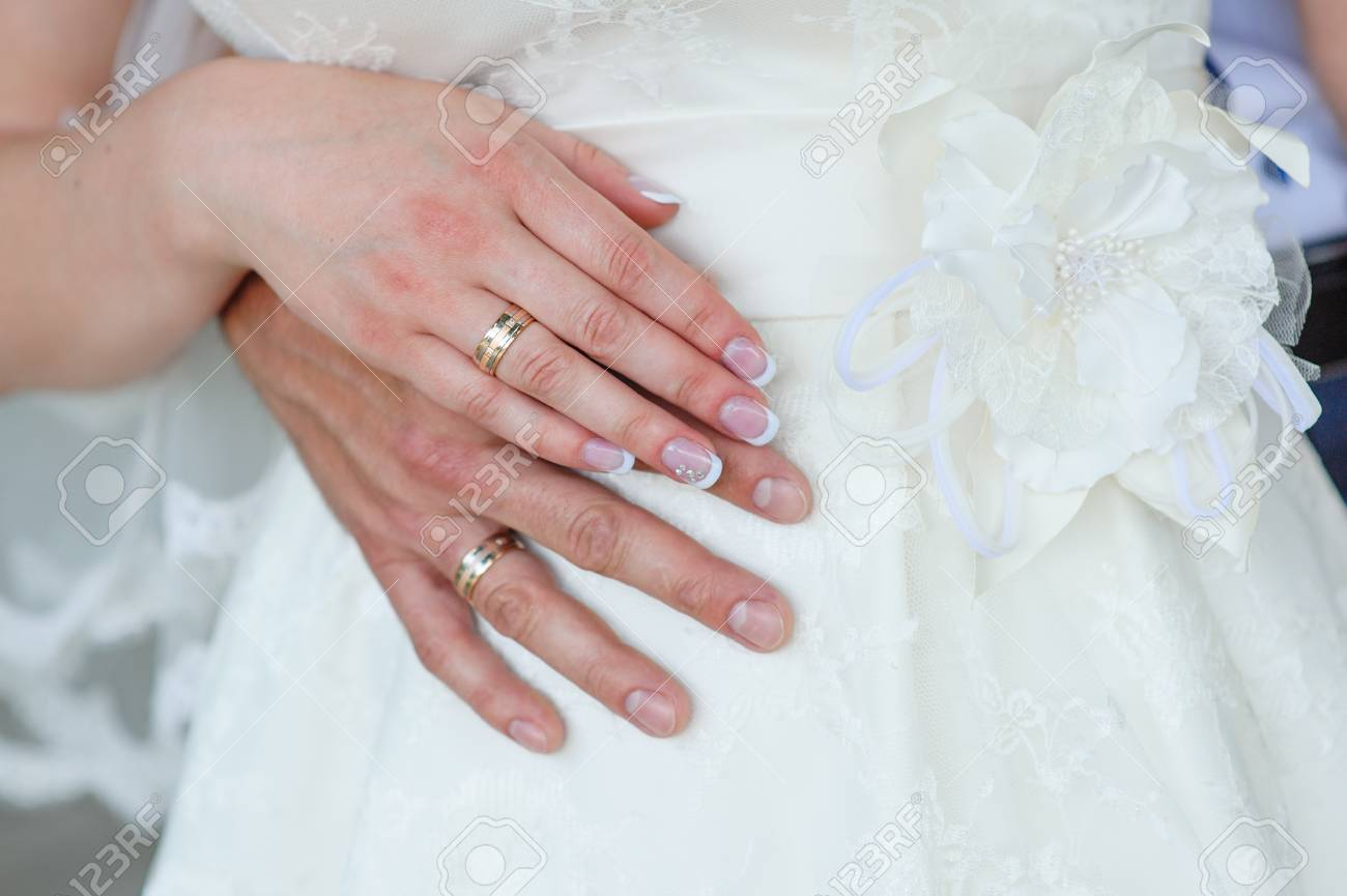 Hands Of The Groom And The Bride With Wedding Rings. Stock Photo ...