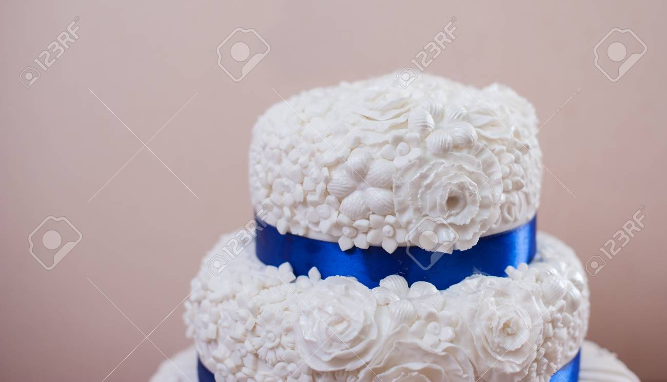 Classic White Wedding Cake With Blue Ribbon. Stock Photo, Picture ...