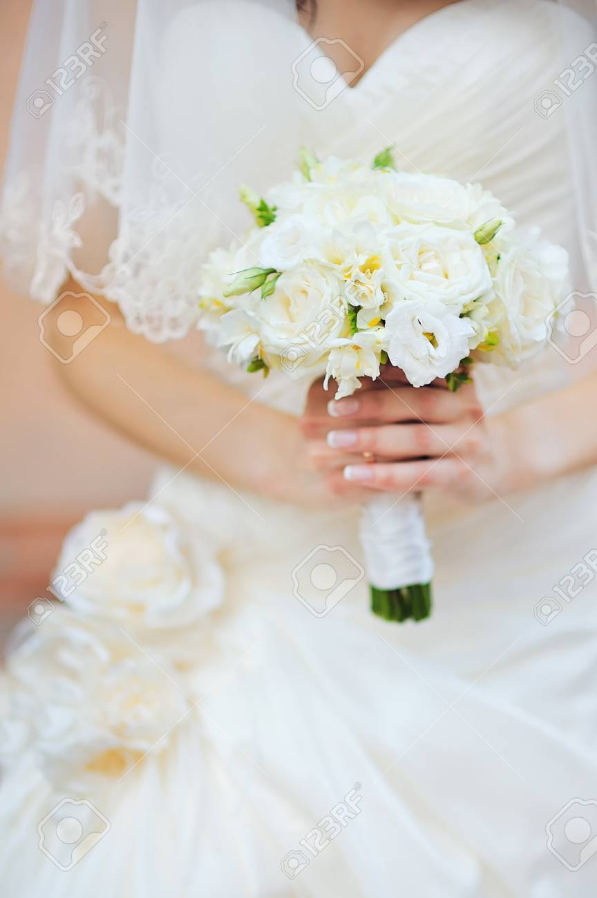 Wedding Flowers Bouquet In Bride Hands With White Dress On ...