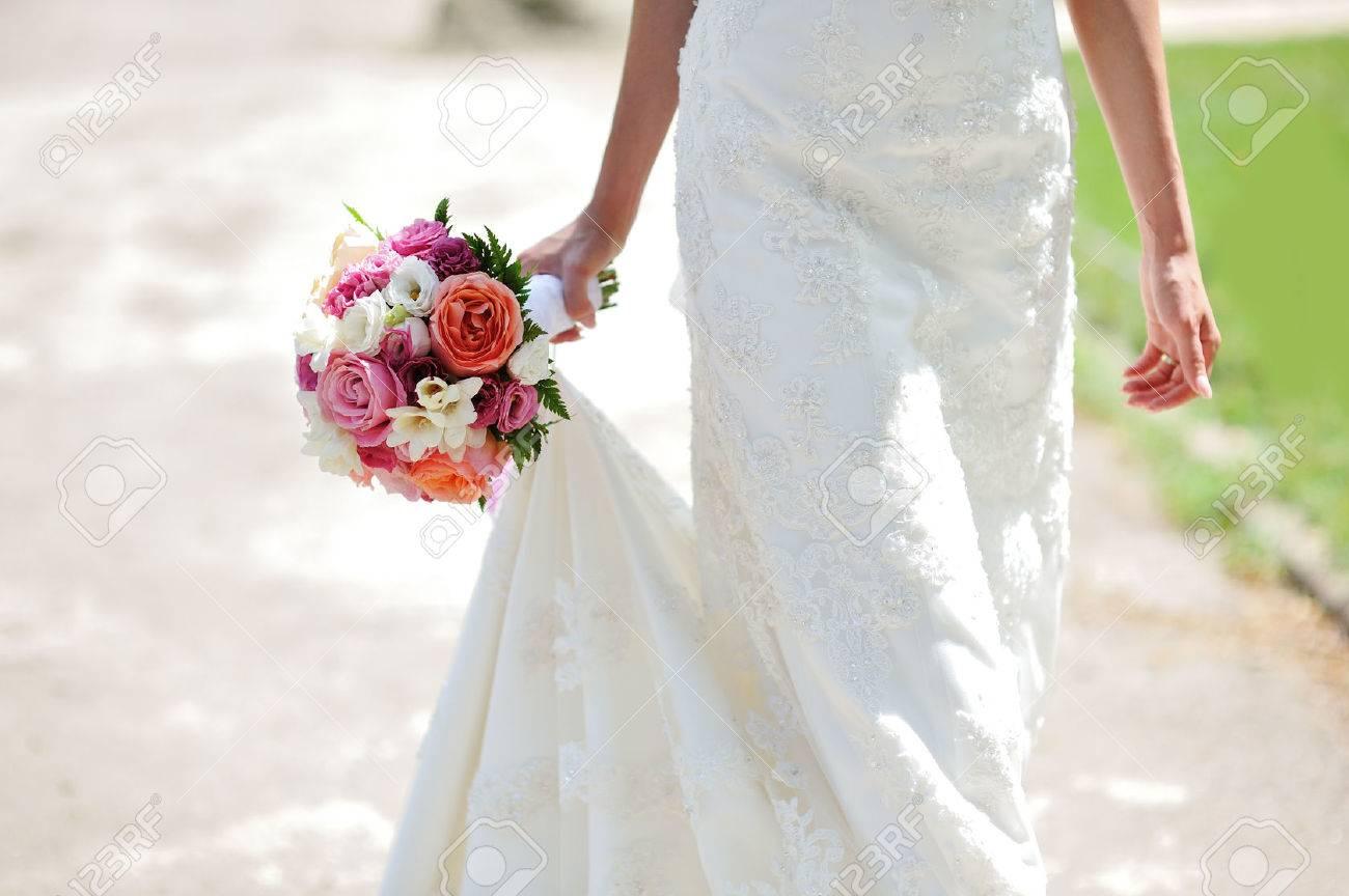 Wedding bouquet in hands of the bride - 54874797