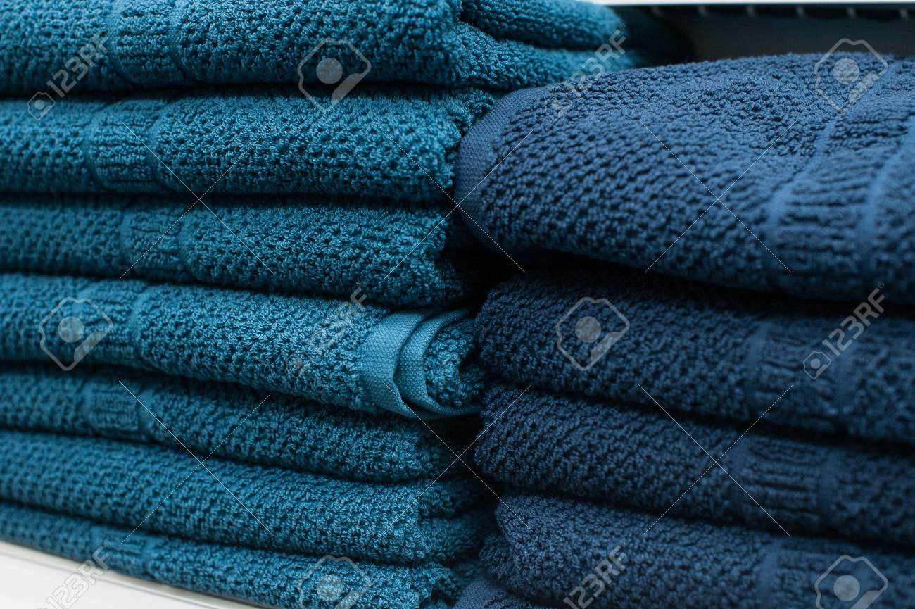 Blue Towels On The Shelf In The Closet Stock Photo, Picture And ...