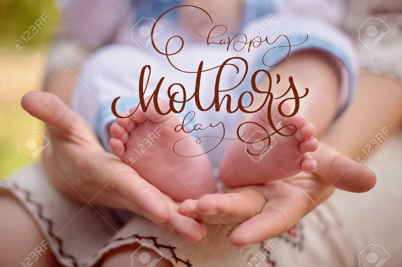 mother hold the feet of her newborn son and happy mothers day text calligraphy lettering