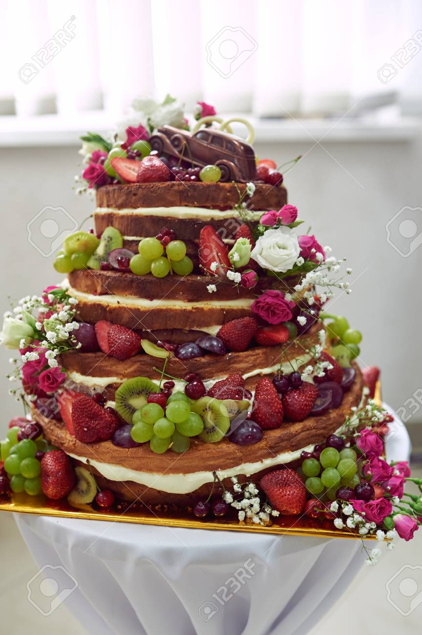 Beautiful Wedding Cake With Fruit On The Table Stock Photo Picture