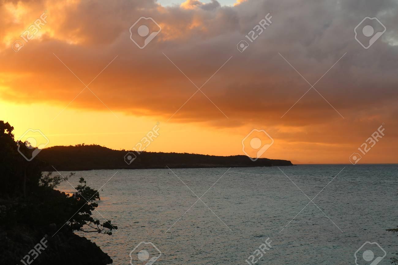Sun set by coast in Cuba Holguin Stock Photo - 92814240