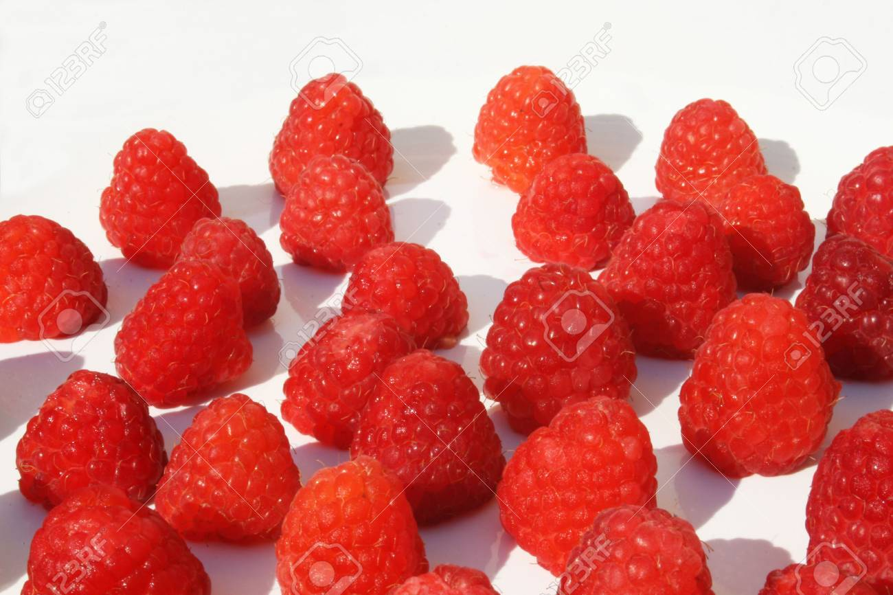 Grouping of raspberries on white plate Stock Photo - 3312947